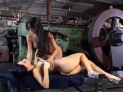Sexy lesbian workers have sex in a plant