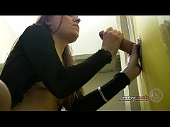 Russian redhead sucks balls and blowjob in hotel gloryhole