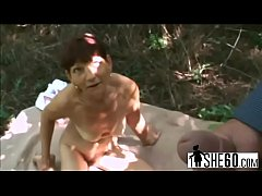 Lovely milf blowing dick outdoors