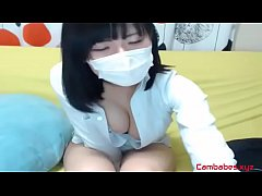 Japanese cutie teasing in non nude webcam show