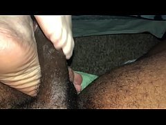 Footjob by mature soles
