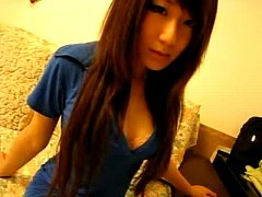 pretty asian chick using cucumber