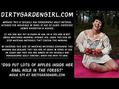 Dirtygardengirl put lots of apples inside her anal hole in the forest