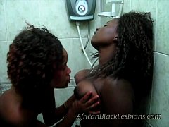 Light skinned sista Lisha fucked by dark African babe in shower