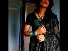 Crossdresser in green saree