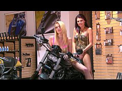 Carmen Blue and Alice Sainz undressing and teasing in a motorbike shop