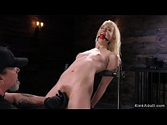 Skinny blonde in metal device bondage fingering hairy pussy to orgasm