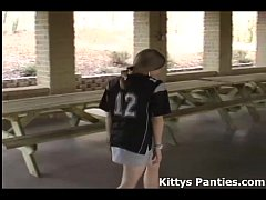 Kitty playing in a football jersey and miniskirt