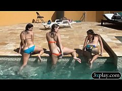 Three teen coeds groupsex in the pool