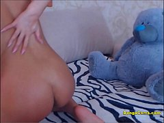 Young skinny slut rubbs her ass and pussy