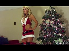 sexy blonde stripping naked under the tree