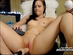 Hot brunette getting fucked by dildo machine on cam