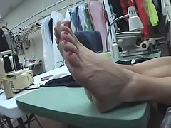 Unaware Seamstress With Very Sexy Soles Feet