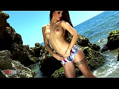 Hot teen with big boobs Susy Gala stripping in the rocks