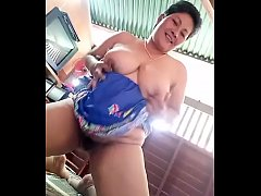 Thai aunty sporting a bush juggling her boobs