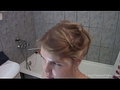 Cute teen with tan lines enjoys her shower