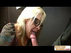 Blonde Milf in stockings gives head