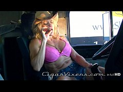 Mandy K SMOKES a cigar