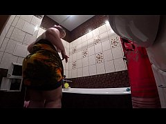 Candid camera behind the scenes, bbw with a shaking butt in a cream after an erotic shooting is washed in the shower.