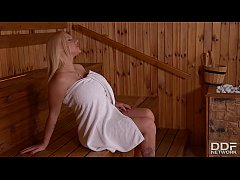 Intimate moments of masturbation make Dolly Fox orgasm on the sauna bench