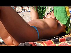 Fuckable MILF tanning on the beach