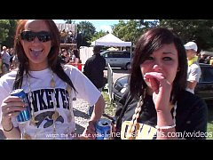 partying and flashing tits while tailgating outside iowa city football game