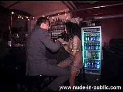 wild girl dancing nude at the bar