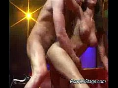 Nasty babe does porn on stage