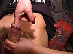 Two girls inserting their fingers deep down in a guy's cock