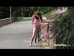 HD Public Peeing - Redhead babe Kattie pisses on a path