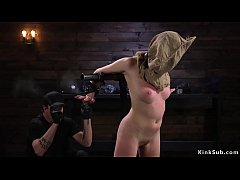 Hooded blonde slave Cadence Luxe in device bondage gets double whip then suffers water bondage