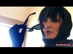 Mistress Madeline with big naturals fucks with a strapon in hardcore femdom