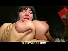 Busty barmaid spreads her legs for him