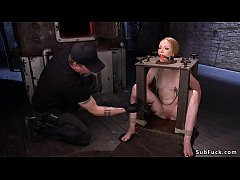 Newbie blonde slave Katy Kiss gagged and tied up in wooden stock nipples clamped