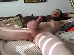 Stroking big hard cock on couch