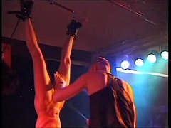 Fetish Club Punishment On Stage of blonde slavegirl in bondage and whipping
