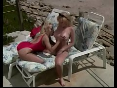 Busty blonde sluts lick each other's pussies while sun bathing