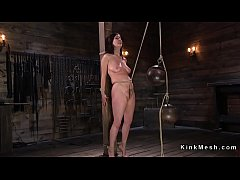 Brunette slave Cherry Torn in bondage gets nipples clamped and paddled