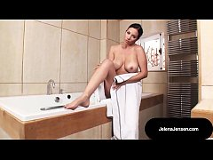 Jelena washes and plays with her lovely titty melon patch in her tub!