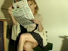 Blonde MILF farting while reading the newspaper...
