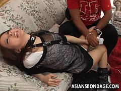 Cute little Asian bimbo wanks her wet pussy
