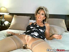 Hot milf puts a dildo in her ass