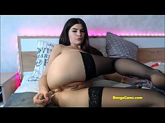 BongaCams sexy teen stretches her butt with a glass dildo