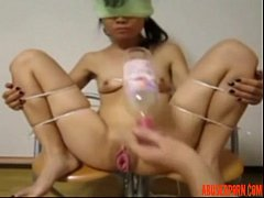 Asian Slave Fisted and Fucked with a Bottle in Bondage anal slave