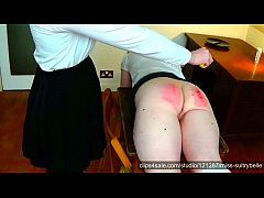Miss Sultrybelle caning a Dublin sub.