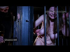 Girl with big titties poked inside a cage