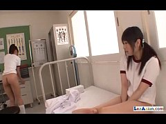 2 Schoolgirls In Training Dress Kissing Fingering Pussies On The Bed In The Surg