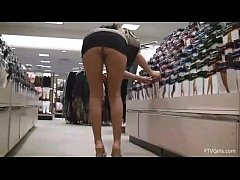 girl shows off her goods while shopping at the department store
