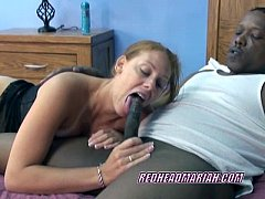 Redhead Mariah in a black dress and sucking cock