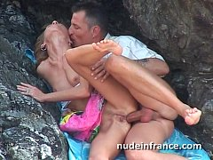 Amateur couple doing anal sex on a beach